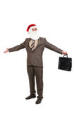 Businessman in suit with santa hat and briefcase Stock Image