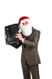 Businessman in suit with santa hat and briefcase Stock Photos