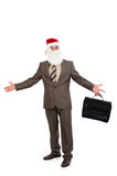 Businessman in suit with santa hat on head Stock Photography