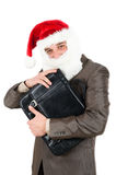Businessman in suit with santa hat on head. Royalty Free Stock Images