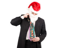 Businessman in suit with santa hat on head. Royalty Free Stock Photo