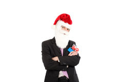 Businessman in suit with santa hat on head. Royalty Free Stock Photos