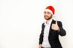 Businessman in suit with santa hat on head. Isolated over white background Royalty Free Stock Photography