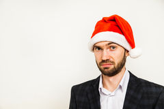 Businessman in suit with santa hat on head. Isolated over white background Stock Photography