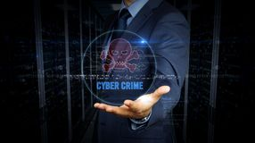 Businessman and screen with skull hologram. A businessman in a suit and screen with pirate skull symbol hologram. Man using virtual display interface. Cyber stock images