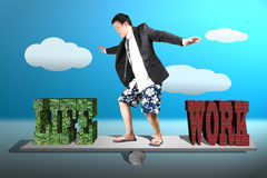 Businessman with suit, shorts and beach shoes surfing on seesaw Stock Images