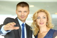 Businessman in suit show to mature woman something amazing Royalty Free Stock Images