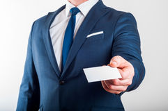 Businessman in suit is showing business card Royalty Free Stock Photos