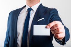Businessman in suit is showing business card Stock Image