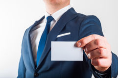 Businessman in suit is showing business card Royalty Free Stock Photo