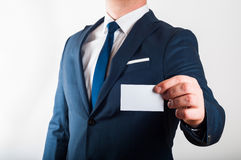 Businessman in suit is showing business card Royalty Free Stock Image