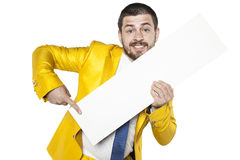 Businessman in a suit shows a golden place for your text Stock Photos