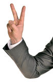 Businessman in suit shows two fingers Stock Photo