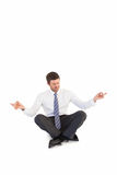 Businessman in suit sitting in lotus pose Stock Photography