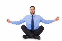 Businessman in suit sitting in lotus pose Stock Image