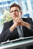 Businessman in suit sitting in office Royalty Free Stock Images