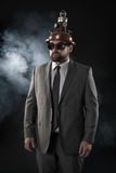 Businessman on a suit smoke background Stock Photos