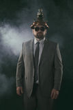 Businessman on a suit smoke background Royalty Free Stock Images