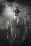 Businessman on a suit smoke background Royalty Free Stock Photo