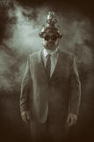 Businessman on a suit smoke background Royalty Free Stock Image