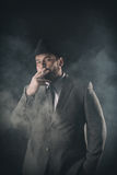 Businessman on a suit smoke background Stock Images