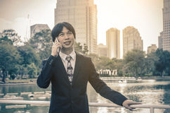 Businessman in suit  speaking on the phone Stock Photography