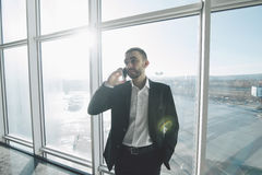 businessman in suit speaking on the phone in office Royalty Free Stock Photography