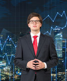 Businessman. In suit standing on city background Royalty Free Stock Photos