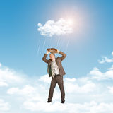 Businessman in suit standing on cloud and covered Royalty Free Stock Photography
