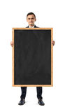Businessman in suit standing and holding blackboard in wooden frame, isolated on white background Stock Images