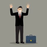 Businessman in a suit surrendering Stock Image