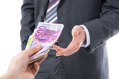 Businessman in a suit takes a bribe Stock Photos