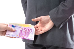 Businessman in a suit takes a bribe. Concept - corruption. Businessman in a suit takes a bribe Stock Photos