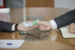 Businessman in a suit takes a bribe. Corruption. Businessman in a suit takes a bribe Stock Photos