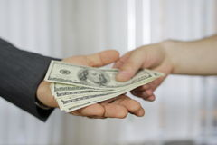 Businessman in a suit takes a bribe Royalty Free Stock Images