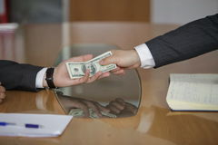 Businessman in a suit takes a bribe. Corruption. Businessman in a suit takes a bribe Stock Photography