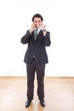 Businessman in suit talking with cell mobile phone with fist up Stock Image