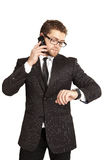 Businessman in a suit talking on the phone. Businessman in a suit talking. Isolated over white Stock Photography