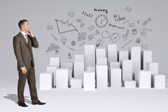Businessman in suit thinks. Many white cubes with Stock Photography