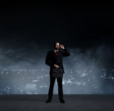 Businessman in suit and tie. Black background with copy space. B Royalty Free Stock Photography