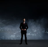 Businessman in suit and tie. Black background with copyspace. Bu Stock Photos