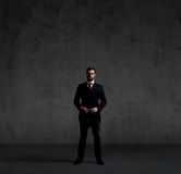 Businessman in suit and tie. Black background with copyspace. Bu Royalty Free Stock Photography
