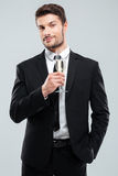 Businessman in suit and tie with glass of champagne Stock Photo