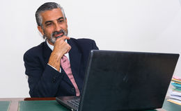 Businessman in a suit and tie, in his studio. Stock Photography