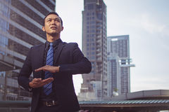 Businessman in a suit and tie with outstretched hand. For implementation of graphic. Concept: Your objects are here Royalty Free Stock Images