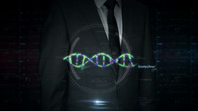 Businessman touch screen with biotechnology and DNA helix hologram. A businessman in a suit touch screen with biotechnology DNA helix hologram. Man using hand on stock footage