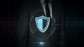 Businessman touch screen with cyber shield hologram. A businessman in a suit touch the screen with cyber security shield hologram. Man using hand on virtual stock footage