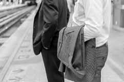 Businessman with suit at train station - black and white tone. Stock Photography