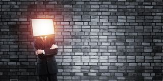 Businessman with TV instead of head. Stock Photography