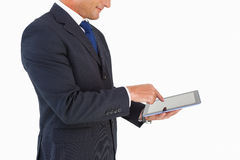 Businessman in suit using digital tablet Royalty Free Stock Photography